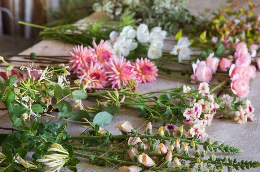 Picked flowers on wooden surface ready for arranging
